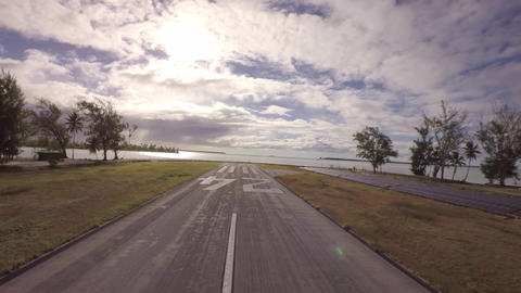 Takeoff towards coconut island and solar panels along the runway - Tetiaroa, Tah Footage