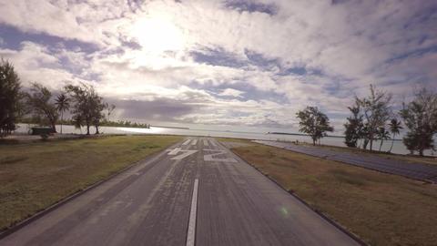 Takeoff towards coconut island and solar panels along the runway - Tetiaroa, Tah Footage