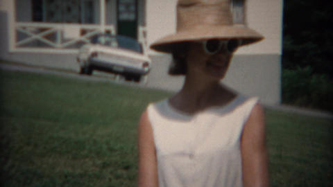 1968: Family enjoying summer sunshine drinking cans of soda pop Footage