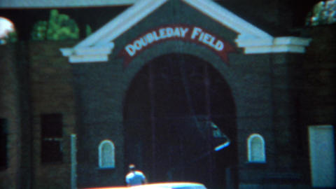 1969: Doubleday field and classic cars in parking lot Footage