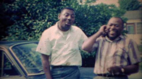 1967: African American brothers clowning around in suburban driveway Footage
