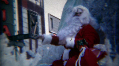 1967: Santa Claus waving on Christmas parade float route Footage