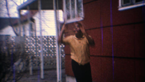 1967: Kids shooting basketball backyard garage hoop Footage