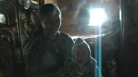 Woman with child in her arms Footage