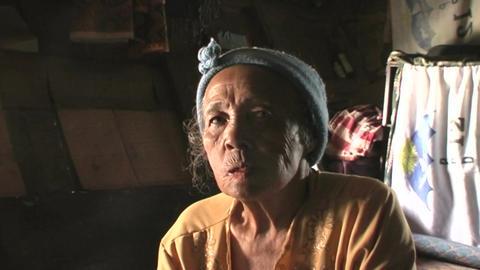 Older woman chews on bald honor Footage