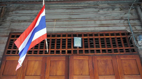 Thai flag hanging above door home ビデオ