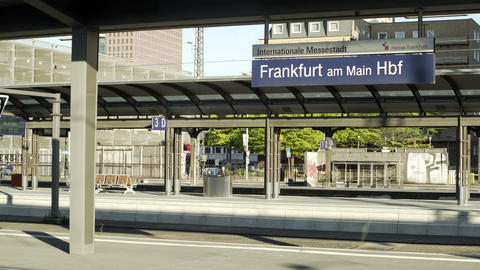 Frankfurt Outdoor Hauptbahnhof Sign and Train Arrives Handheld Footage