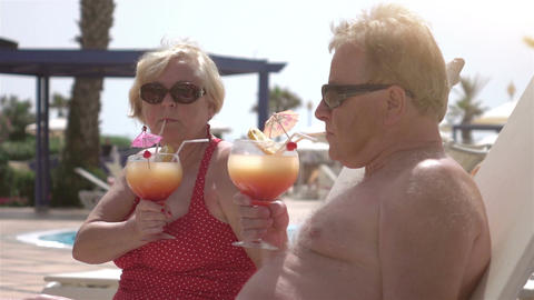 Video of senior couple drinking cocktails in real slow motion Footage