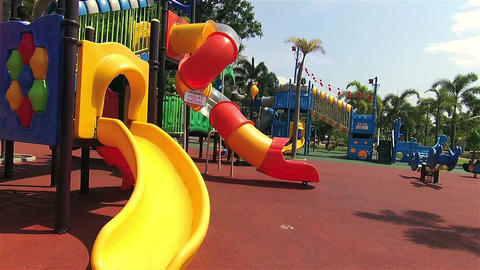 Walk to the playground in public park at sunny day Footage