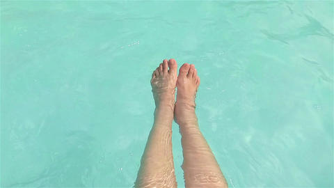 Dipping feet in water Footage