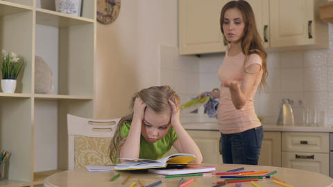 Strict mother criticizing daughter for mistakes in homework, lack of support Footage