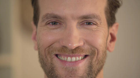 Healthy smile of handsome young man looking into camera, male face close-up Footage