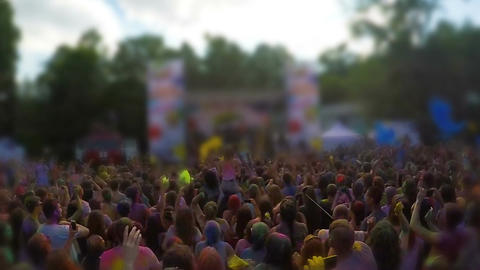 Excited crowd throwing yellow powder in air, enjoying good mood at festival Footage
