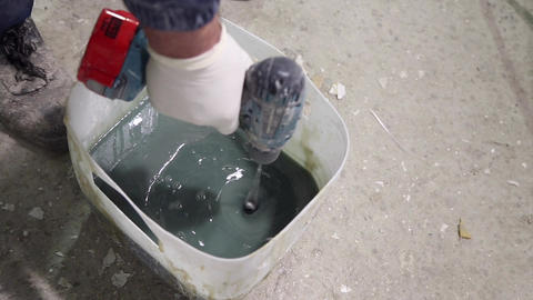 Master mixes glue in the bucket GIF