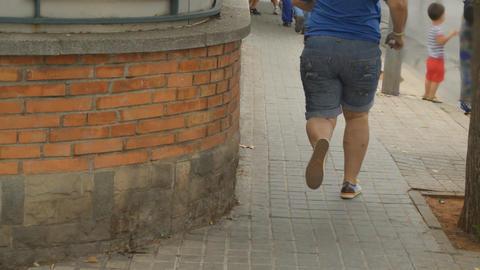 Fat Person Runs On Sidewalk Live Action