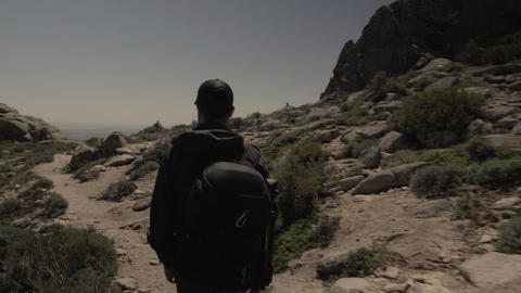 Track shot of man hiking in the desert Footage