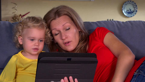 mother with daughter blow kiss to father on tablet video conversation Footage