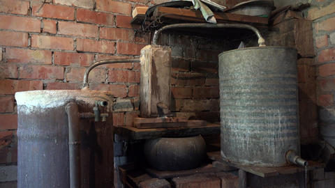 domestic old boiler to obtain strong vodka alcohol indoor. 4K Footage