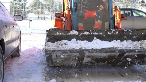 small tractor clean winter snow in block flat house parking in winter. 4K Footage