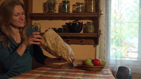 Herbalist woman put dried hop herbs on table. 4K Footage