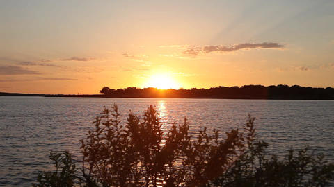 Vibrant orange sunset on Grapevine Lake Footage