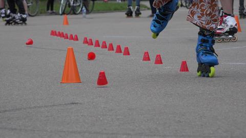 roller skaters foot ride on one wheel slalom. 4K Footage