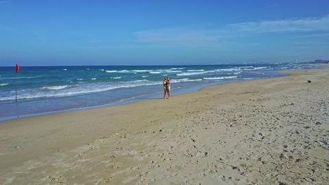 Drone Flies around Happy Couple Making Selfie on Ocean Beach Footage