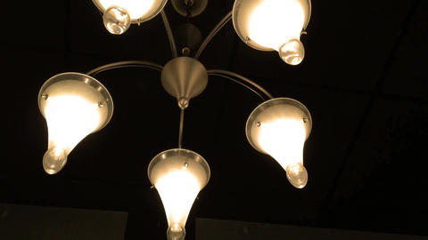 Camera pans up to luxurious cinematic chandelier lighting Footage