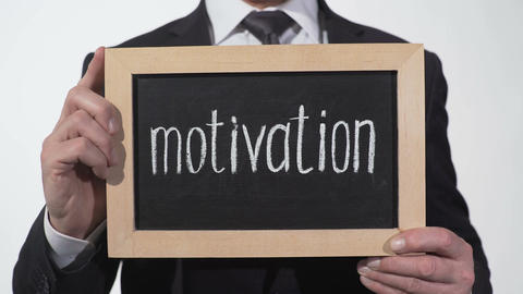 Motivation written on blackboard in businessman hands, self-improvement webinar Footage