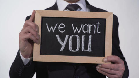 We want you phrase on blackboard in businessman hands, promising job offer Footage