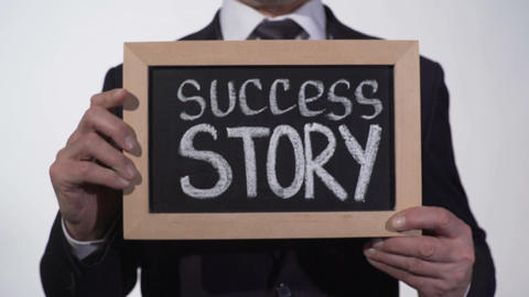 Success story written on blackboard in businessman hands, start new business Footage
