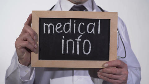 Medical info text on blackboard in doctor hands, consultation with therapist Footage
