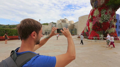 Curious tourists photographing sights of contemporary art on phone camera Footage