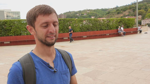 Young male tourist filming landmarks and places of interest on his smartphone Live Action