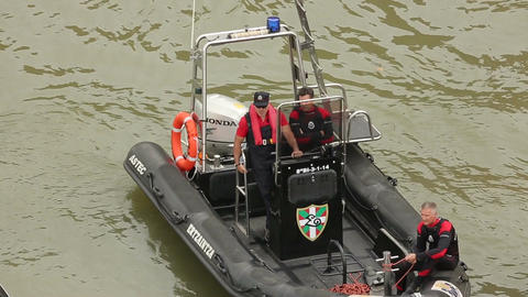 Coastal guards on duty in patrol boat, securing public safety on water and shore Footage