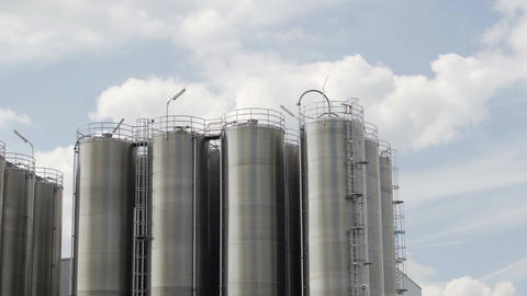 Industrial Stainless Steel Tank Farm Clouds Timelapse Footage