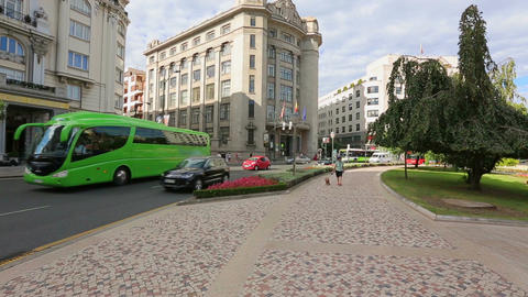 Busy city traffic in Bilbao city center, buses and cars driving near main square Footage