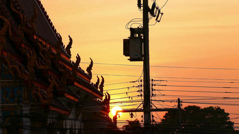 Buddhist Temple Sunset Silhouettes Electrical Wires Time Lapse 4k Footage