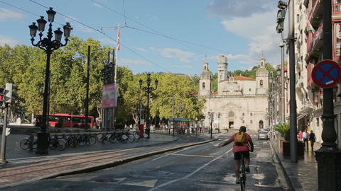 Cars and buses on their way to Old Town district in Bilbao, city transportation Footage