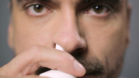 Rhinitis and allergy. Close up view of man's nose, male dripping nose drops Footage