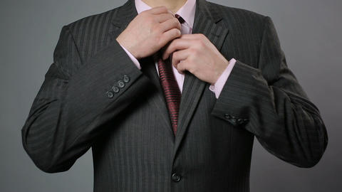 Businessman adjusting his necktie and jacket, close-up. Stylish men's wear Footage