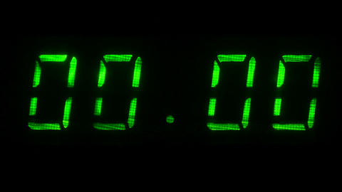 Digital clock with fluorescent display shows 00:00 in green color ビデオ