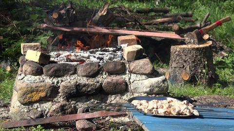 wood smoldering in stone fireplace to ready roast shashlik. 4K Footage