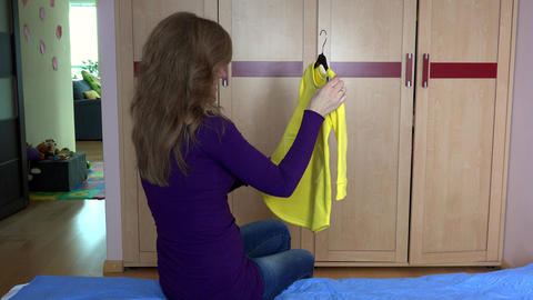 Mom ask her cute daughter girl hiding in closet to put dress on Footage