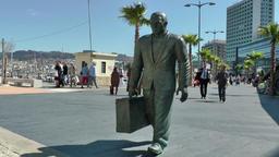 Spain Galicia City of Vigo 043 statue of a traveler in the harbor Filmmaterial