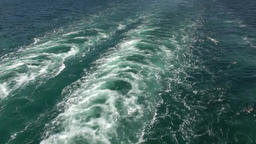 Spain Galicia City of Vigo 054 double stern wave in turquoise water of ocean Footage