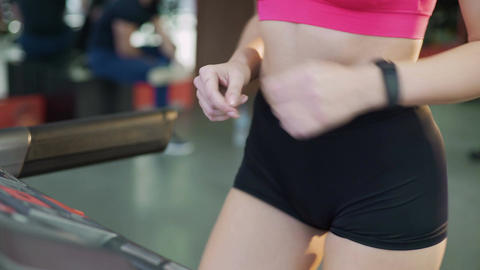 Beautiful body of active lady at workout, sportive woman walking on treadmill Live Action