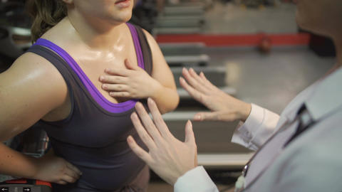 Female doctor consulting overweight woman, helping her to recover after workout Footage