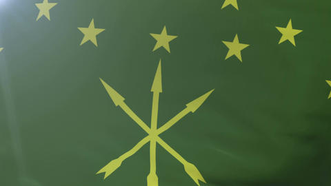 Flag of Adygea waving on flagpole in the wind, national symbol of freedom Footage