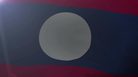 Flag of Laos waving on flagpole in the wind, national symbol of freedom Footage